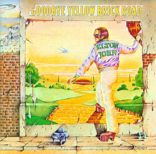"""The title track to Elton's double-album masterpiece, which was released at the peak of his fame and the peak of his powers, the song sees him (or his lyricist, Bernie Taupin) showing some real animosity towards fame. Just like in The Wizard of Oz -- an obvious influence on the lyrics -- the song's narrator chases a dream for years, only to realize that the keys to happiness are to be found in the simpler things in life, and sometimes were available to you all along. Taupin also looked at the dark side of fame on """"Candle In The Wind"""" and explored similar ground on """"A Simple Life"""" and """"Home Again."""""""
