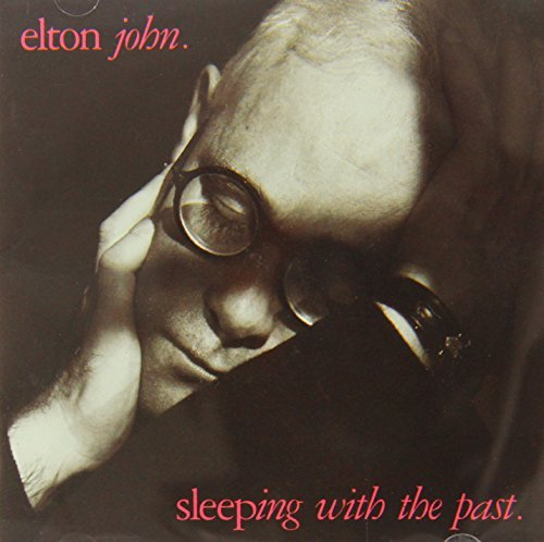 """'Sleeping With The Past' was kind of a dud of an album, but """"Sacrifice"""" is one of Elton's loveliest ballads, despite the very """"soft rock"""" production. Believe it or not, this was his first ever solo #1 hit single in England (he'd previously topped the charts with """"Don't Go Breaking My Heart"""" with Kiki Dee)."""