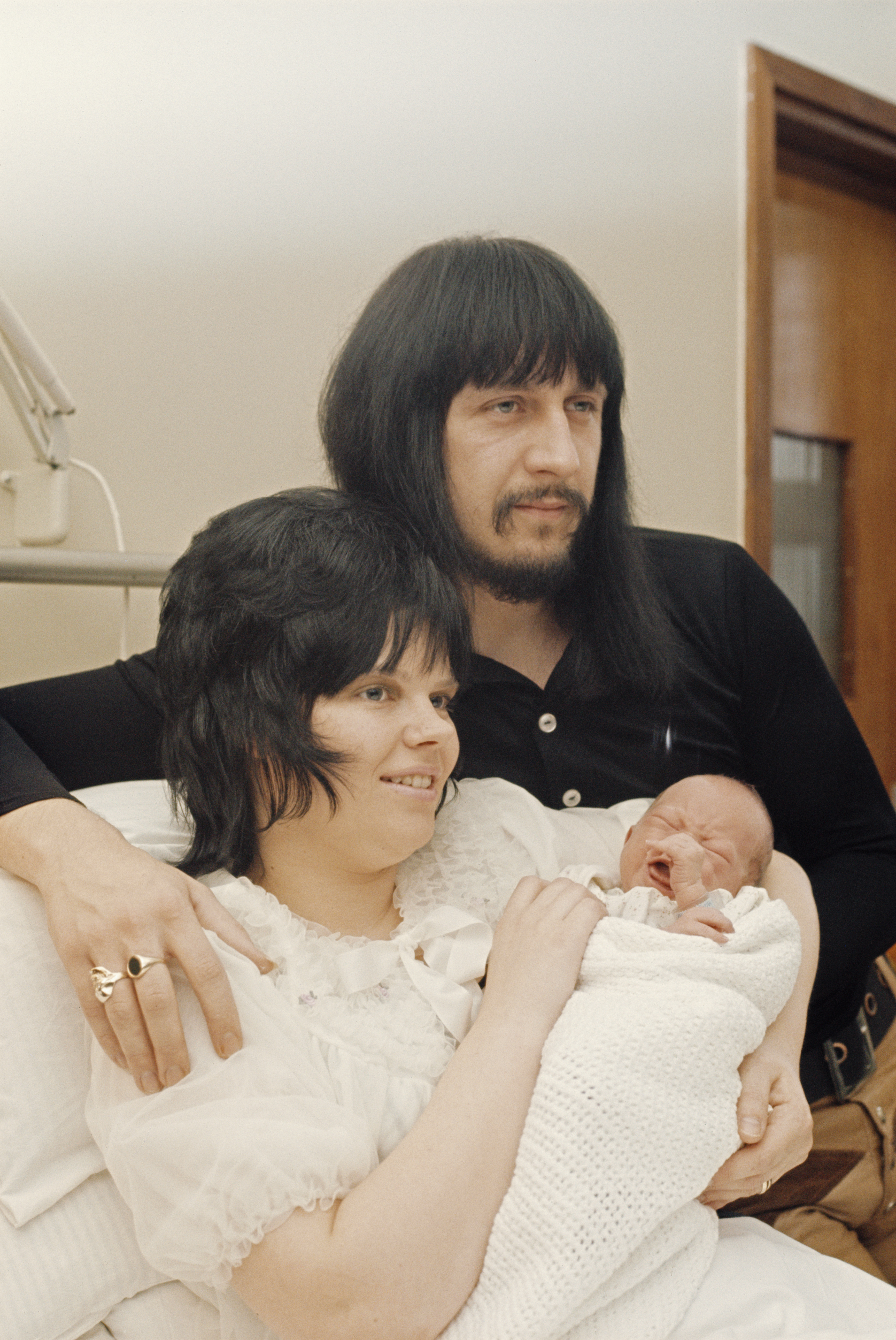 English musician John Entwistle (1944 - 2002), bass guitarist of rock band The Who, with his wife Alison and baby son Christopher at Queen Charlotte's Hospital in London, 1972. (Photo by Keystone/Hulton Archive/Getty Images)