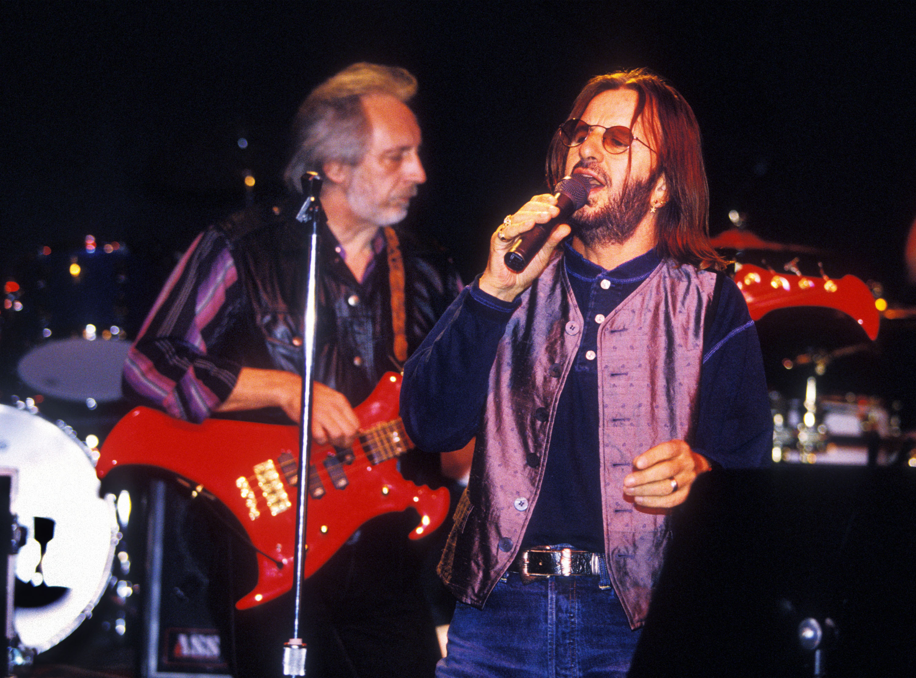 VANCOUVER, CANADA:  John Entwistle plays with the Ringo Starr in the summer of 1995 in Vancouver, Candada.  Entwistle died June 27, 2002.  (Photo by Jeff Vinnick/Getty Images)