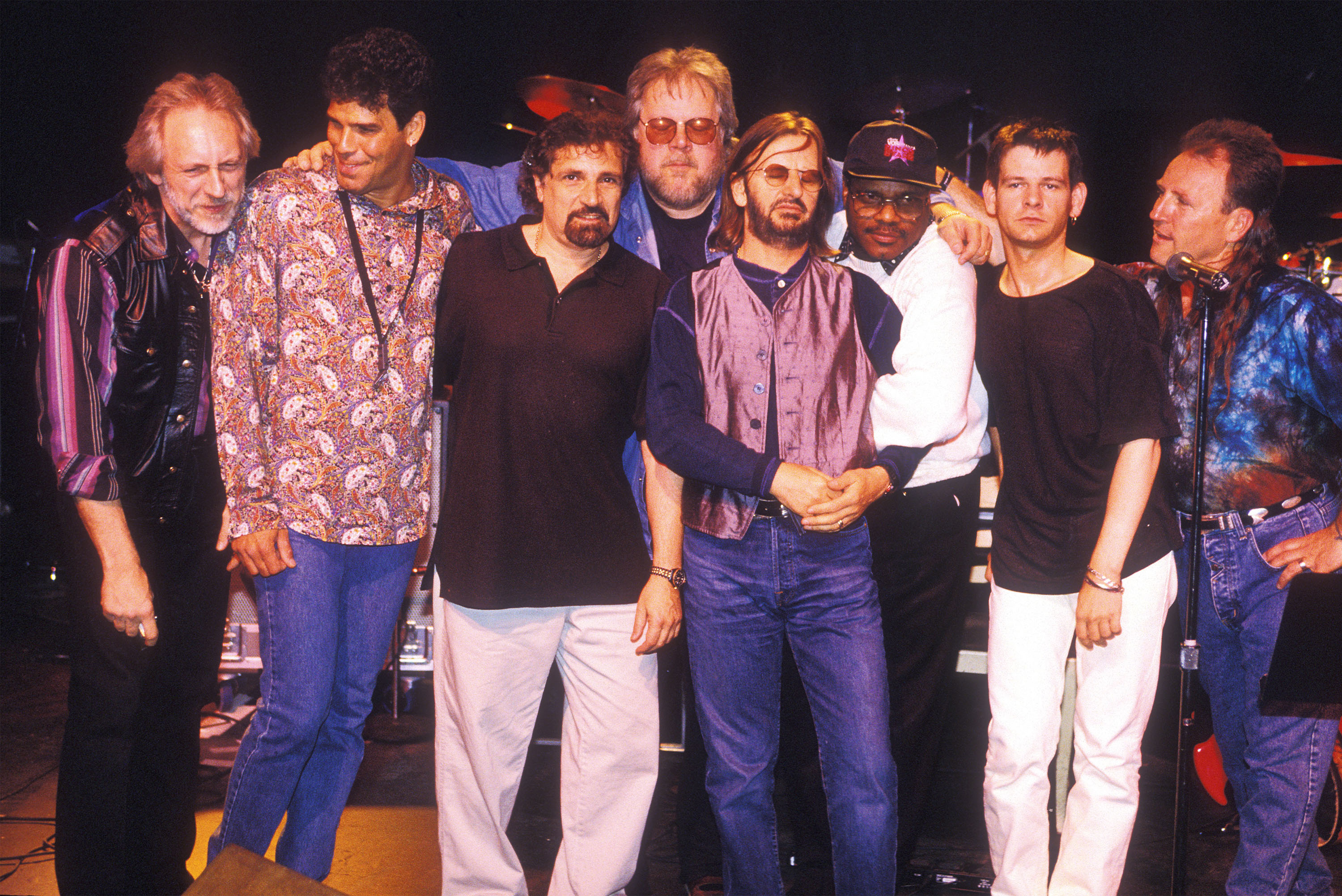 VANCOUVER, CANADA:  John Entwistle (L) poses with the Ringo Starr band in the summer of 1995 in Vancouver, Candada.  Entwistle died June 27, 2002.  (Photo by Jeff Vinnick/Getty Images)