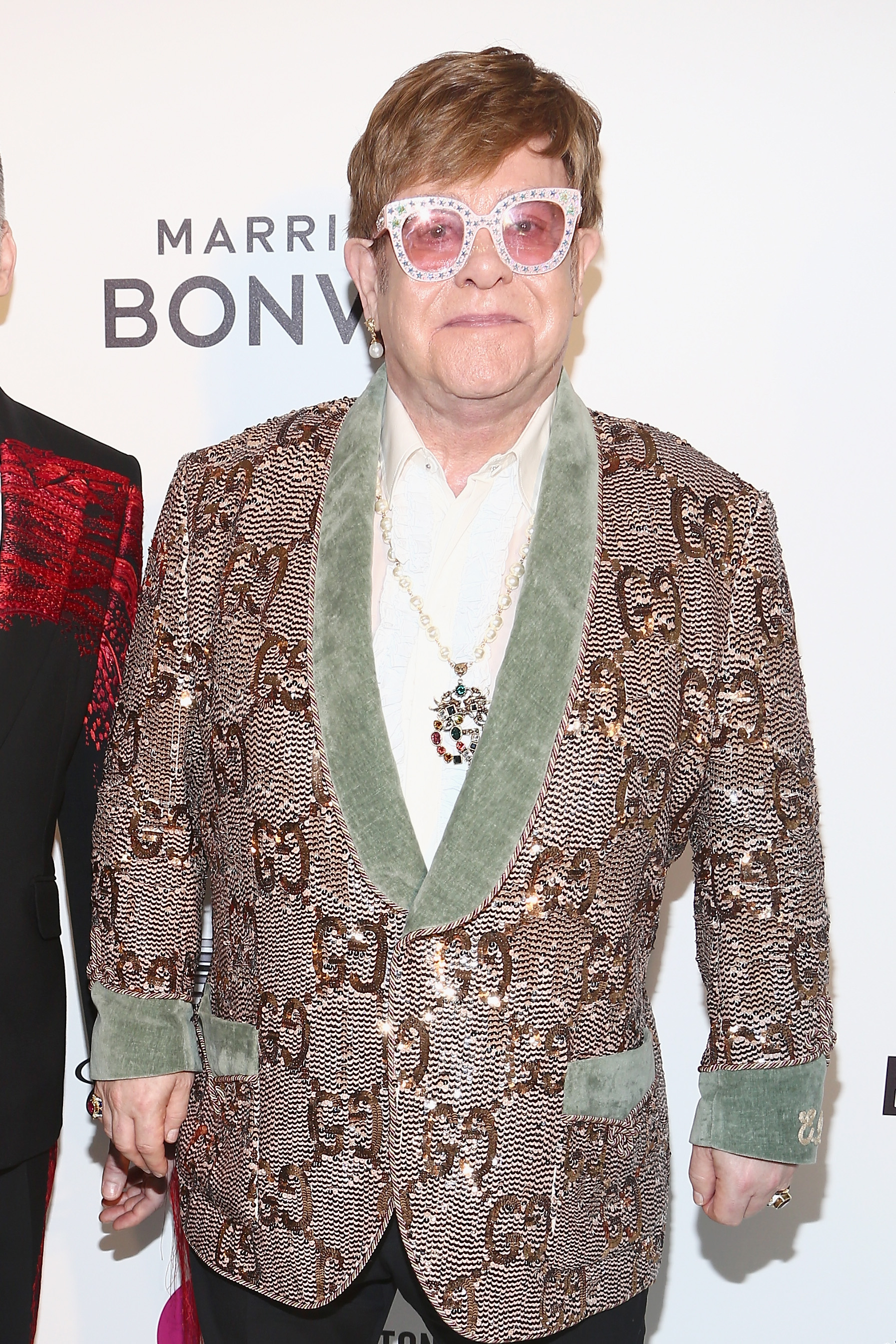 Even the most conservative of Elton John's red carpet looks involve incredible eye wear, which is just one of many reasons why he's so beloved.