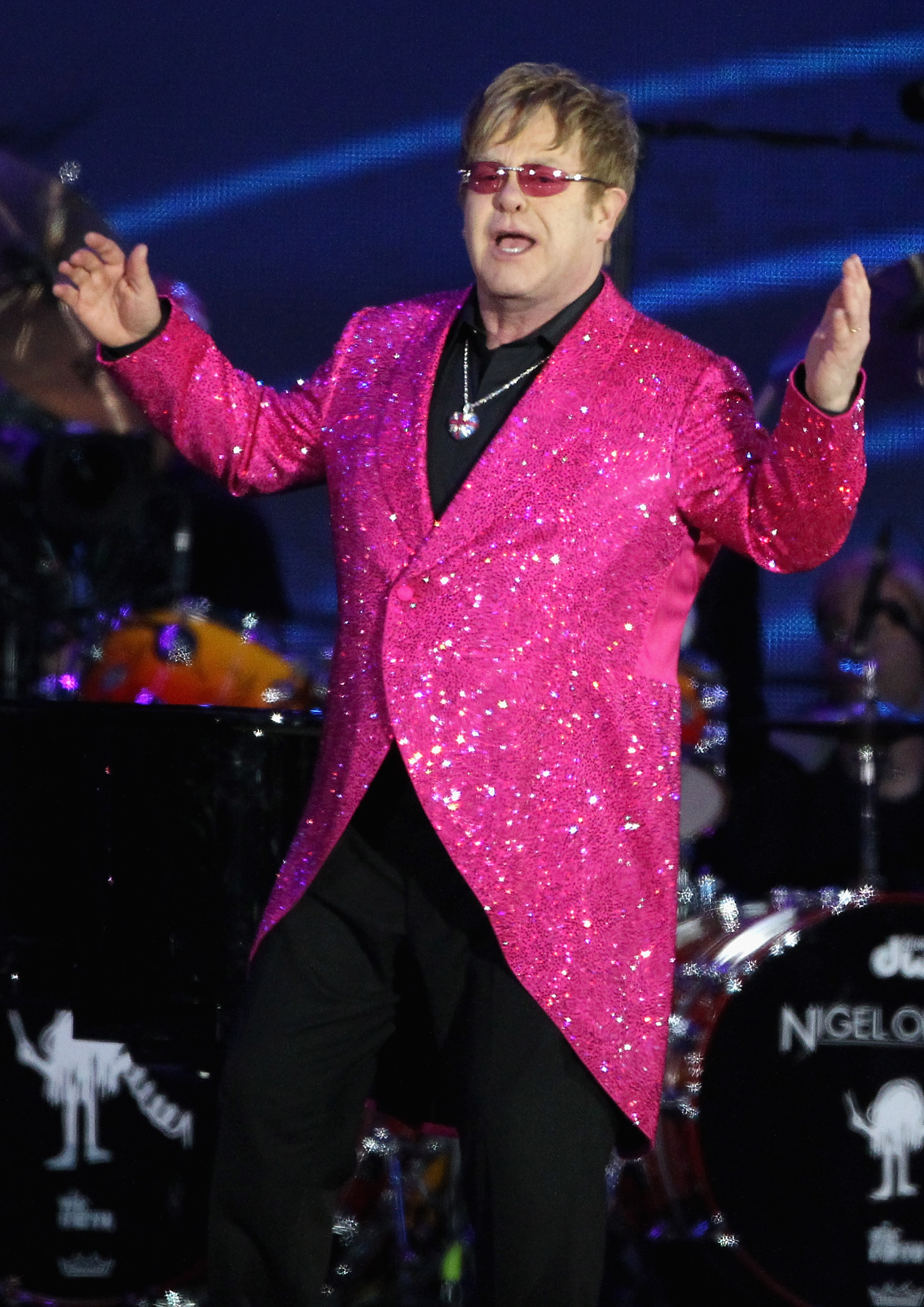 The fact Elton matched the color of his lenses to his sequined blazer is the definition of thoughtful.