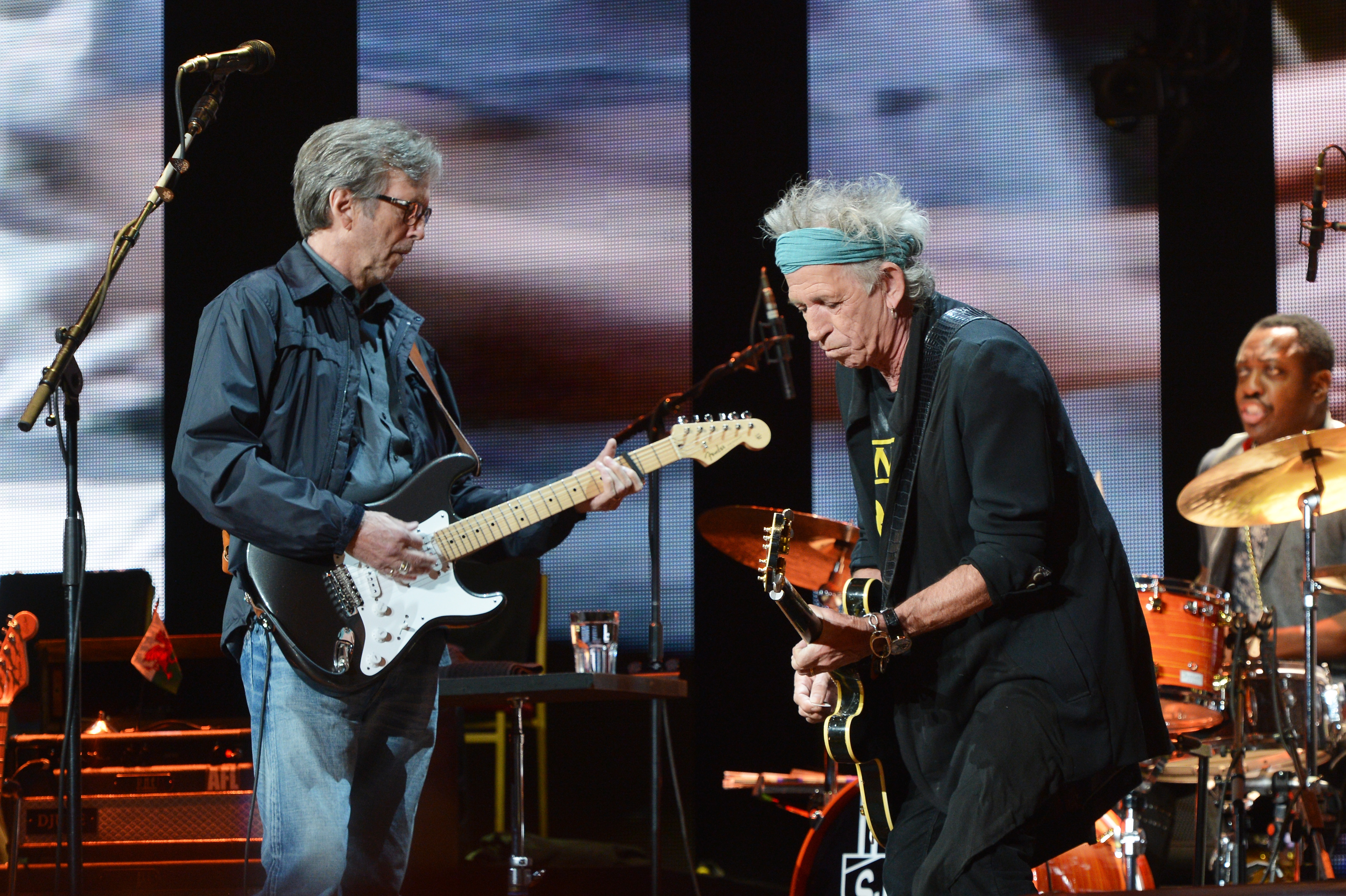 NEW YORK, NY - APRIL 13:  Eric Clapton (L) and Keith Richards perform on stage during the 2013 Crossroads Guitar Festival at Madison Square Garden on April 13, 2013 in New York City.  (Photo by Larry Busacca/Getty Images)