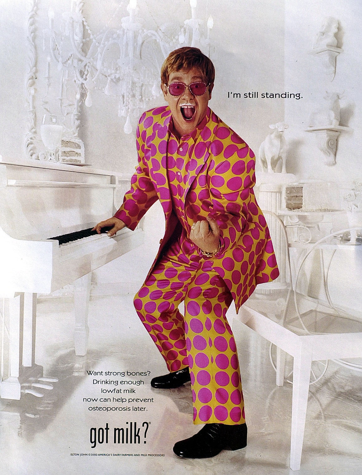 """This isn't a staged photo for the """"Got Milk?"""" campaign. This was actually a candid of Elton enjoying a glass of milk at home."""