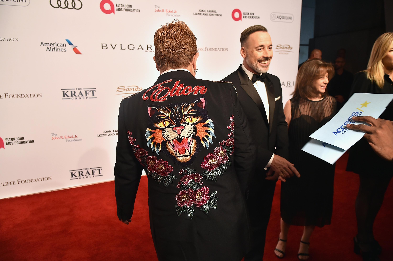 Elton John, and only Elton John, can make an Ed Hardy-inspired design look absolutely elegant.