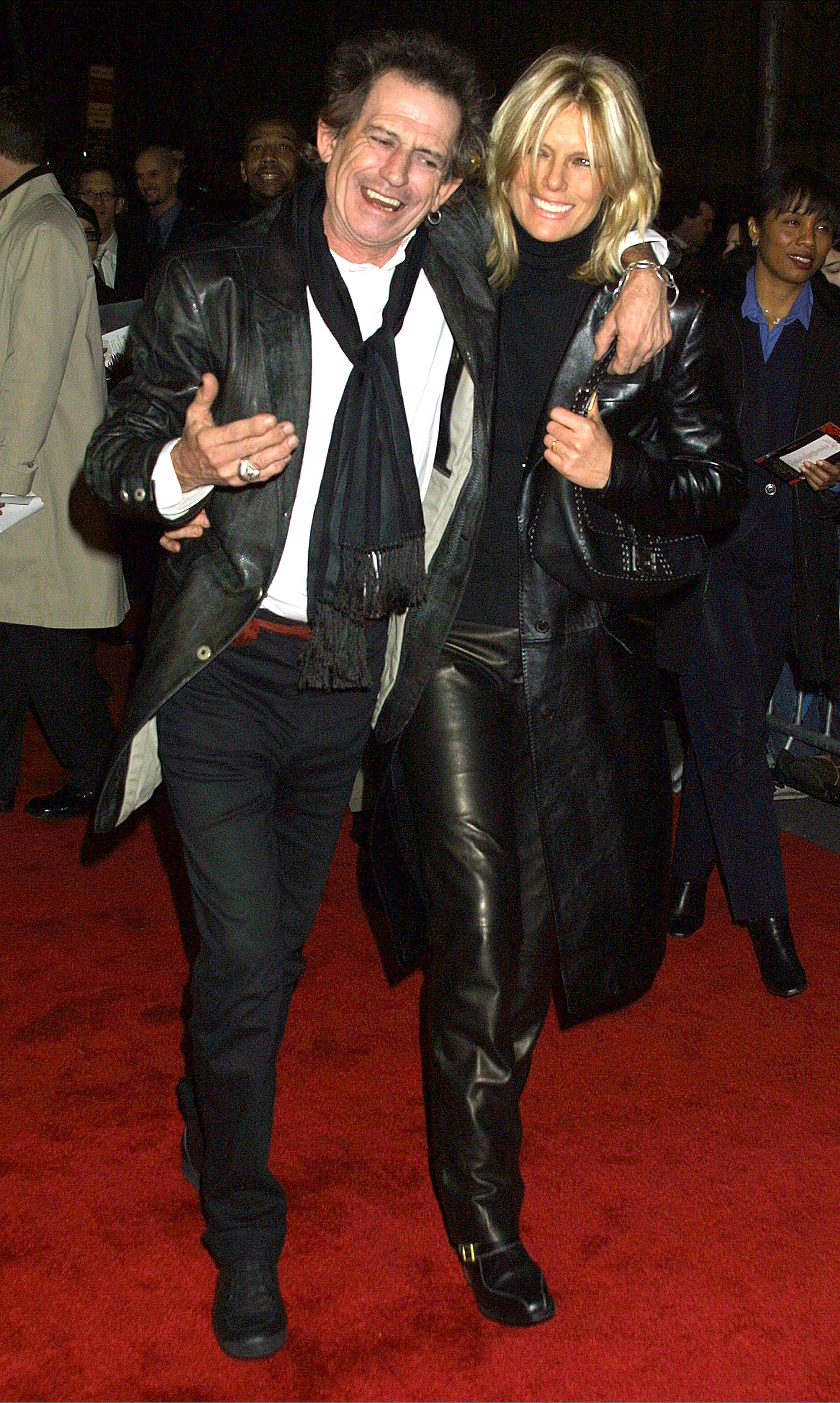 """Guitarist Keith Richards and his wife Patti Hansen attend the premiere of """"Gosford Park"""" December 3, 2001 at the Ziefeld Theatre in New York City. (Photo by George De Sota/Getty Images)"""