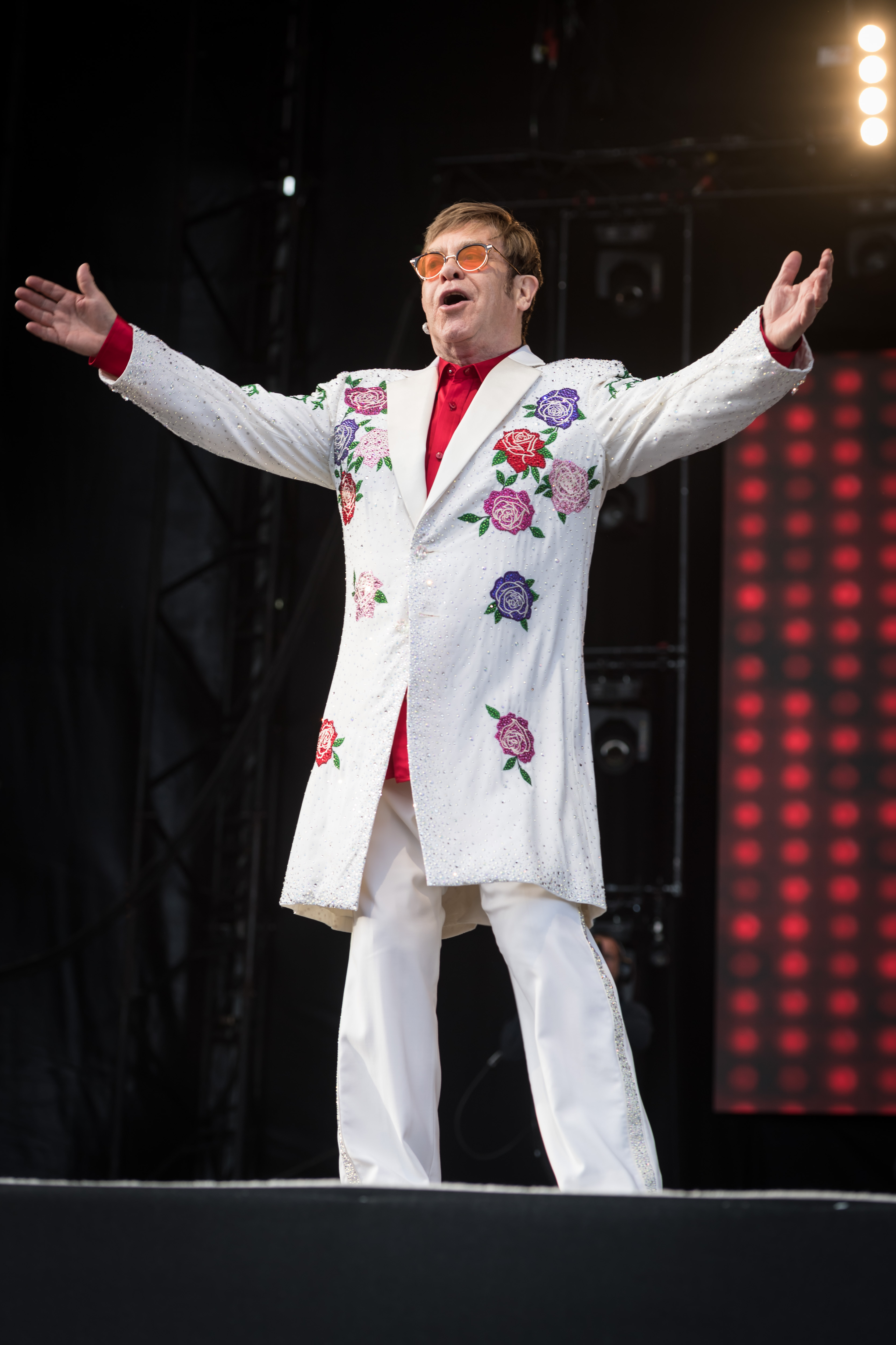 Sir Elton is one of the few people in the history of time that can be both elegant and flashy. He's truly the best!