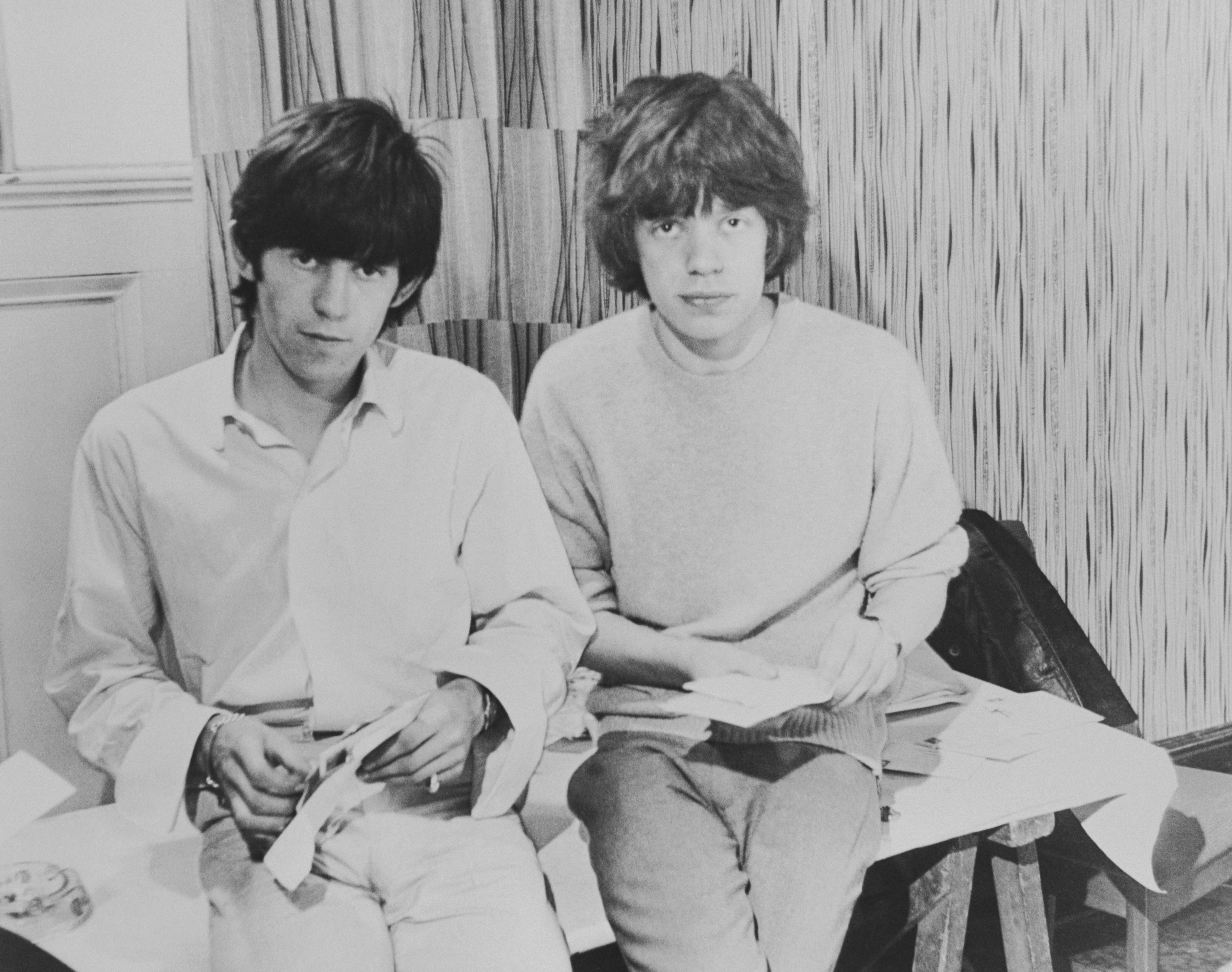 Rolling Stones singer Mick Jagger and guitarist Keith Richards opening fan mail during the early days of the band, circa 1963. (Photo by Keystone Features/Hulton Archive/Getty Images)