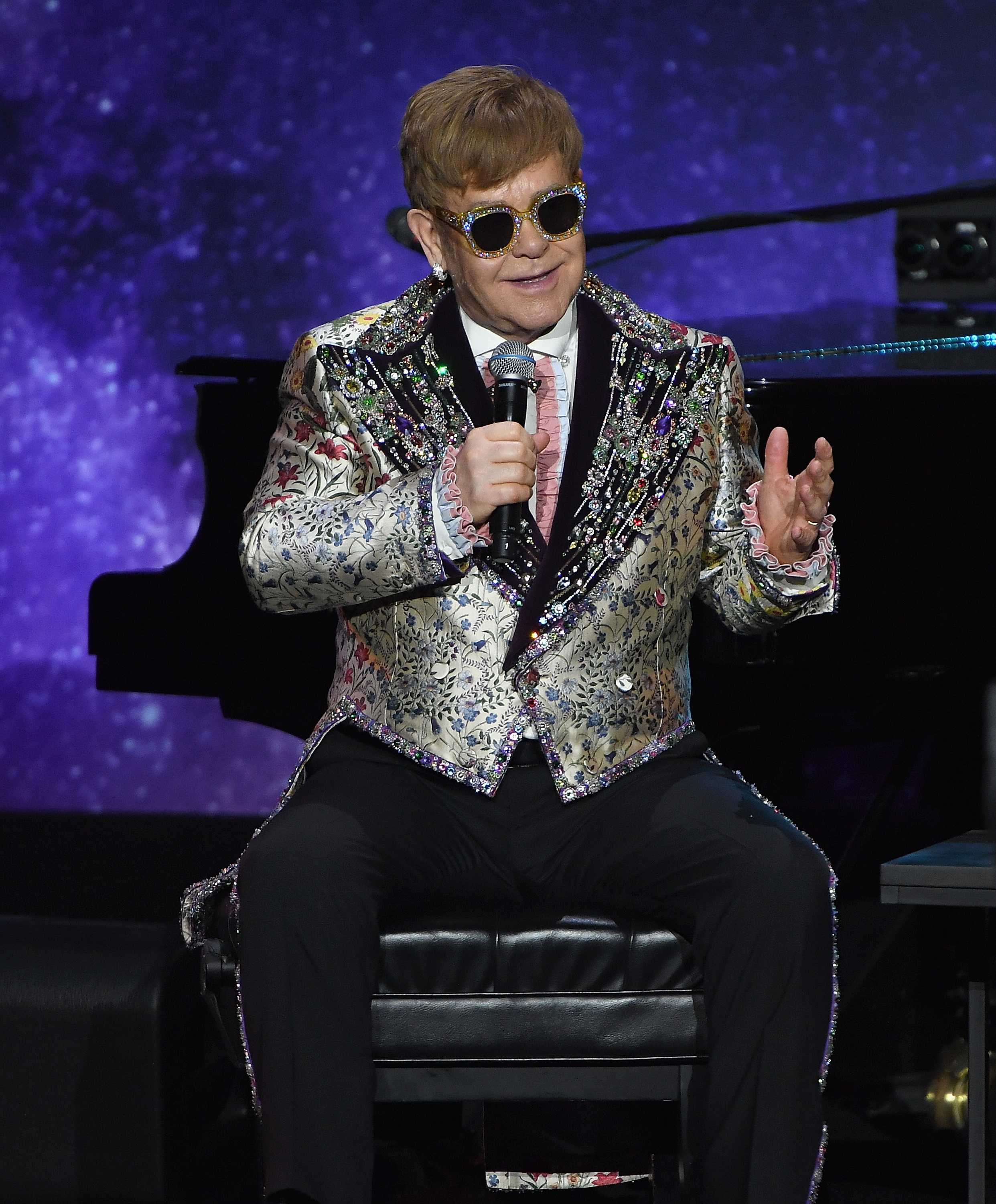 Embroidery, sequins and ruffles?! Elton John has never met an accent he didn't like.