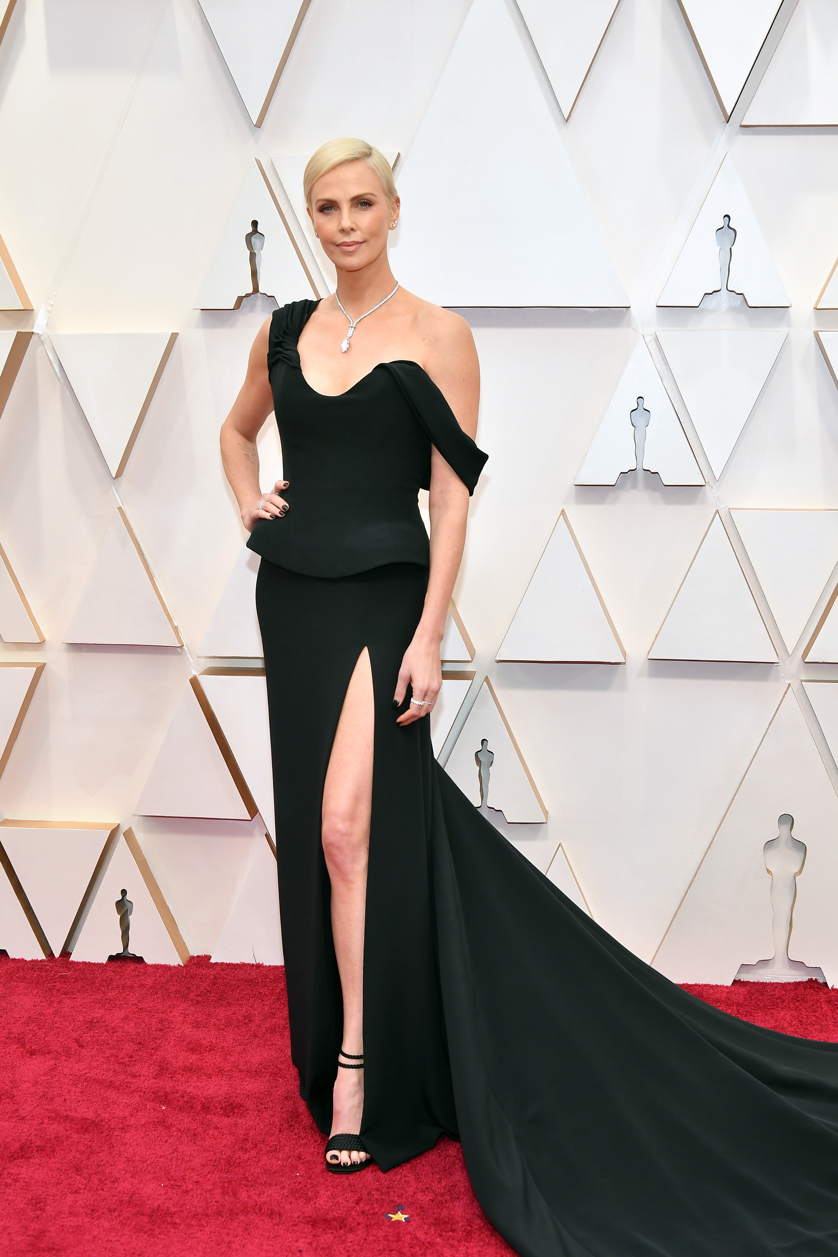 HOLLYWOOD, CALIFORNIA - FEBRUARY 09: Charlize Theron  attends the 92nd Annual Academy Awards at Hollywood and Highland on February 09, 2020 in Hollywood, California.